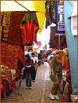 One of the many markets in Peru.showing the wonderful array of colours and designs on offer.