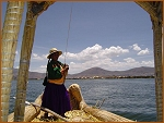 Travelling by reed boat, Lake Titicaca, Peru.